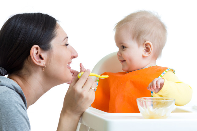 mother feeding her baby food 2