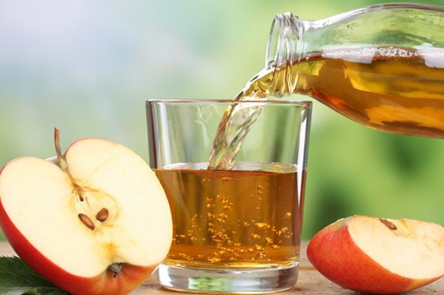 apple juice being poured into a glass 4
