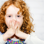 toddler girl covering her mouth 4