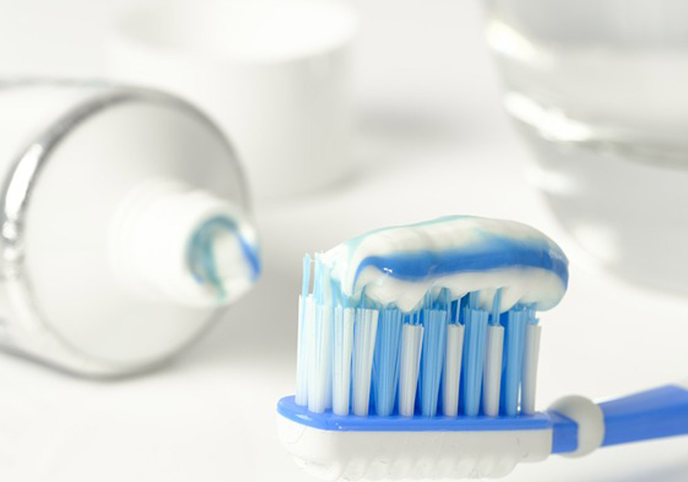 close up of toothbrush with toothpaste on it